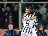 Juventus' midfielder from Argentina Roberto Pereyra celebrates with teammate Juventus' forward from Spain Alvaro Morata after scoring during the Italian Tim Cup semifinal return football match Fiorentina vs Juventus at the Artemio Franchi Stadium in Flore