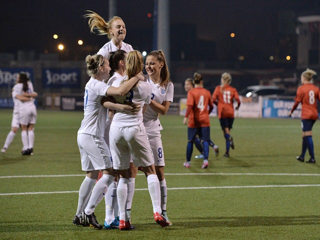 Leah Williamson of England celebrates with team mates after a retaking a last minute penalty during the UEFA U19 Women's Qualifier between England and Norway at Seaview on April 9, 2015 in Belfast, Northern Ireland. The original penalty, taken during the