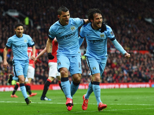 Sergio Aguero of Manchester City celebrates with David Silva as he scores their first goal during the Barclays Premier League match between Manchester United and Manchester City at Old Trafford on April 12, 2015
