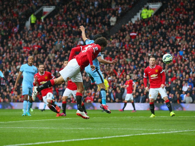 Marouane Fellaini of Manchester United scores their second goal with a header during the Barclays Premier League match between Manchester United and Manchester City at Old Trafford on April 12, 2015