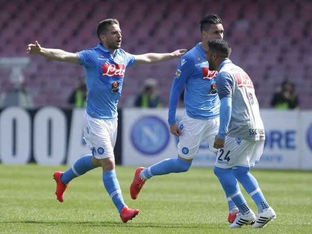 Napoli's forward from Belgium Dries Mertens celebrates with teammates after scoring during the Italian Serie A football match SSC Napoli vs Fiorentina ACF on April 12, 2015