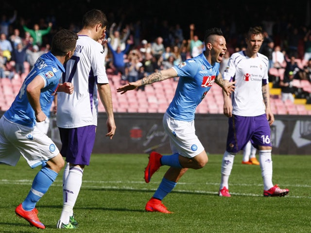 Napoli's forward from Slovakia Marek Hamsik celebrates after scoring during the Italian Serie A football match SSC Napoli vs Fiorentina ACF on April 12, 2015