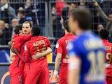 Paris Saint-Germain's Swedish forward Zlatan Ibrahimovic (2ndL) is congratulated by teammates after scoring a penalty during the French League Cup final football match Bastia (SCB) vs Paris Saint-Germain, on April 11, 2015
