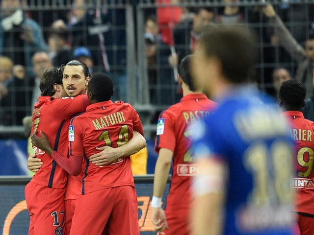 Paris Saint-Germain's Swedish forward Zlatan Ibrahimovic (2ndL) is congratulated by teammates after scoring a penalty during the French League Cup final football match Bastia (SCB) vs Paris Saint-Germain, on April 11, 2015