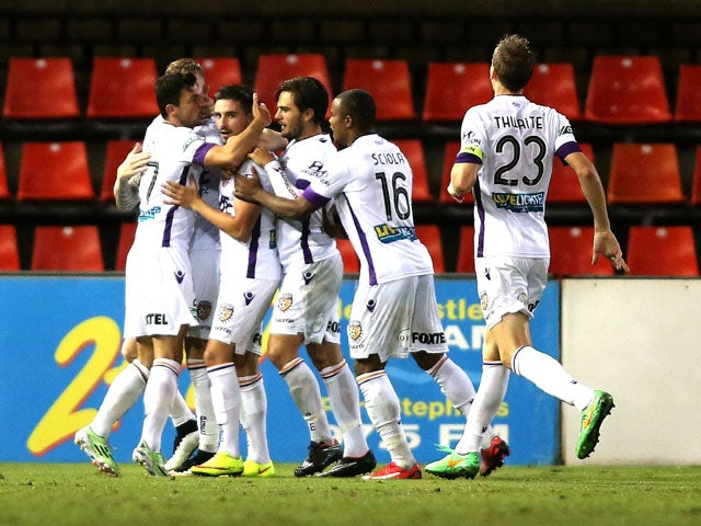 Glory players celebrate a goal during the round 24 A-League match between the Newcastle Jets and Perth Glory at Hunter Stadium on April 6, 2015