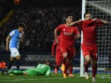 Liverpool's Brazilian midfielder Philippe Coutinho (R) celebrates scoring the opening goal of the English FA Cup quarter-final replay football match between Blackburn Rovers and Liverpool at Ewood Park in Blackburn, north west England on April 8, 2015