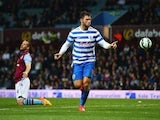 Ron Vlaar of Aston Villa look dejected as Charlie Austin of QPR (9) celebrates as he scores their third goal during the Barclays Premier League match between Aston Villa and Queens Park Rangers at Villa Park on April 7, 2015