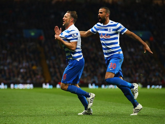 Clint Hill of QPR (6) celebrates with Sandro as he scores their second goal during the Barclays Premier League match between Aston Villa and Queens Park Rangers at Villa Park on April 7, 2015