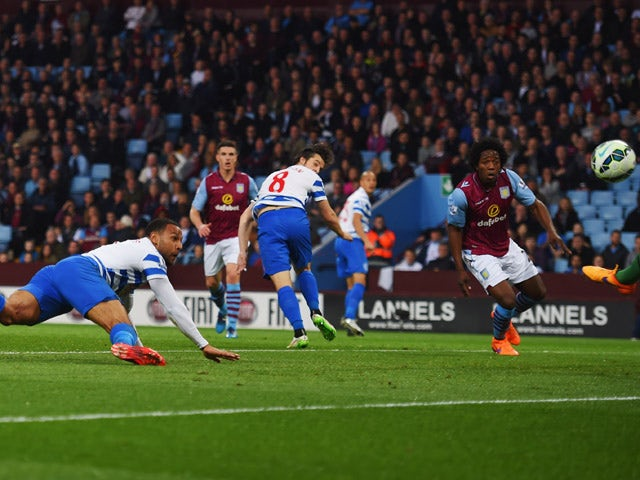 Matt Phillips of QPR scores their first goal with a header during the Barclays Premier League match between Aston Villa and Queens Park Rangers at Villa Park on April 7, 2015