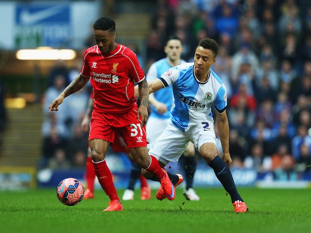 Raheem Sterling of Liverpool holds off Adam Henley of Blackburn Rovers during the FA Cup Quarter Final Replay match between Blackburn Rovers and Liverpool at Ewood Park on April 8, 2015