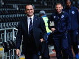 Roberto Martinez arrives at the Liberty with his players ahead of Everton's match with Swansea on April 11, 2015