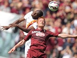 Roma's forward Victor Ibarbo fights for the ball with Torino's midfielder Alessandro Gazzi during the Italian Serie A football match Torino Vs AS Roma on April 12, 2015