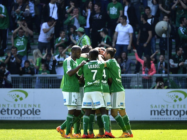 Saint-Etienne players celebrate after French midfielder Franck Tabanou scored a goal during the French L1 football match Saint-Etienne (ASSE) vs Nantes (FCN) on April 12, 2015