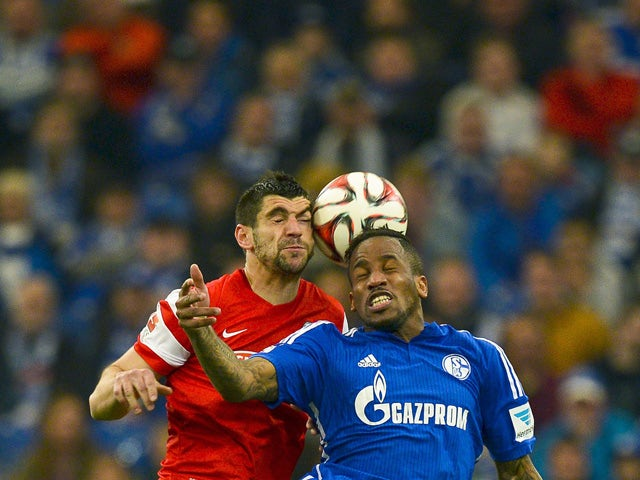Schalke's Jefferson Farfan vies for the ball with Freiburg's Stefan Mitrovic during the German first division Bundesliga football match between FC Schalke 04 v SC Freiburg in Gelsenkirchen,Germany, on April 11, 2015