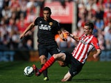 Jake Livermore of Hull City is tackled by Morgan Schneiderlin of Southampton during the Barclays Premier League match between Southampton and Hull City at St Mary's Stadium on April 11, 2015