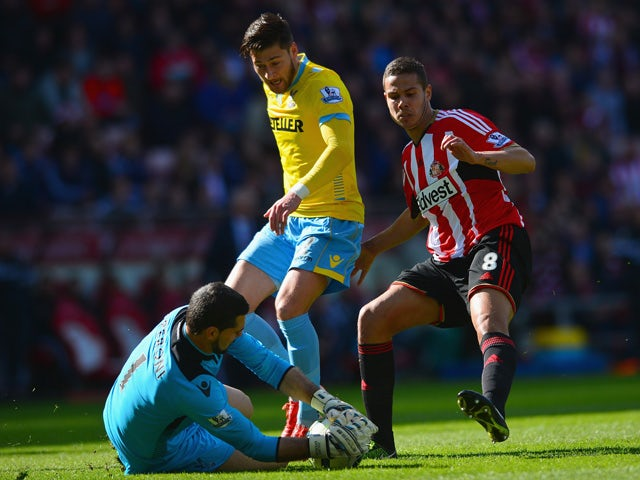 Julian Speroni of Crystal Palace makes the ball safe against Jack Rodwell of Sunderland during the Barclays Premier League match between Sunderland and Crystal Palace at Stadium of Light on April 11, 2015