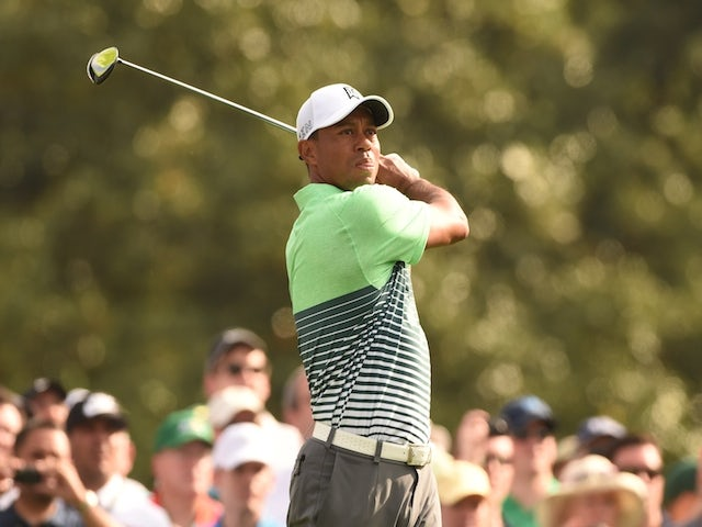 Tiger Woods of the US plays during a practice round for he 79th Masters Golf Tournament at Augusta National Golf Club on April 8, 2015