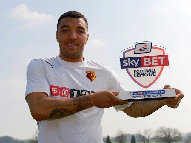 Watford's Troy Deeney poses with his Player of the Month award for March 2015