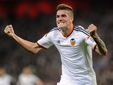Valencia's Rodrigo De Pau celebrates after scoring a goal during the Spanish league football match Athletic Club vs Valencia CF at the San Mames stadium in Bilbao on April 9, 2015