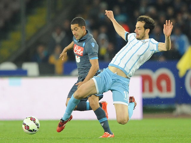 Napoli's player Walter Gargano vies with SS Lazio player Marco Parolo during the Tim cup match between SSC Napoli and SS Lazio at the San Paolo Stadium on April 8, 2015