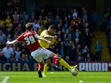 Troy Deeney Watford FC scores the first goal during the Sky Bet Championship match between Watford and Middlesbrough at Vicarage Road on April 6, 2015