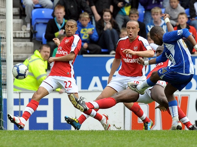 Wigan Athletic's French midfielder Charles N'Zogbia scores his teams third goal during the English Premier league football match against Arsenal at the DW Stadium, Wigan, north-west, England, on April 18, 2010