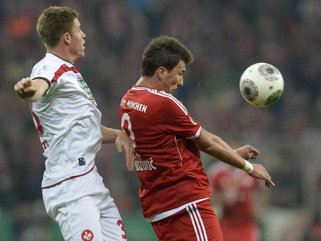 Bayern Munich's Croatian striker Mario Mandzukic and Kaiserslautern's defender Willi Orban vie for the ball during the German Cup (DFB Pokal) semi-final football match Bayern Munich vs 1 FC Kaiserslautern in Munich Southern Germany on April 16, 2014
