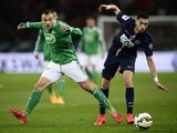St Etienne's French midfielder Yohan Mollo (L) fights for the ball with Paris Saint-Germain's Argentinian midfielder Javier Pastore on April 8, 2015
