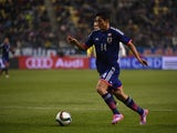 Yoshinori Muto of Japan dribbles the ball during the international friendly match between Japan and Tunisia at Oita Bank Dome on March 27, 2015