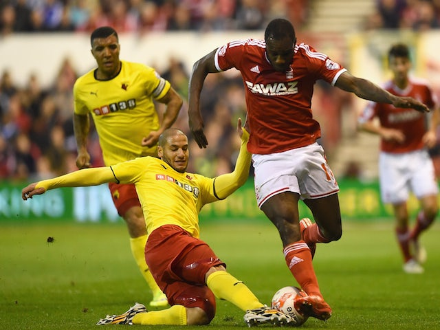 Adlène Guédioura of Watford tackles Michail Antonio of Nottingham Forest during the Sky Bet Championship match between Nottingham Forest and Watford at City Ground on April 15, 2015
