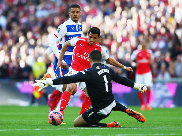Alexis Sanchez of Arsenal shoots past Adam Federici of Reading during the FA Cup Semi Final between Arsenal and Reading at Wembley Stadium on April 18, 2015