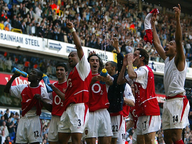 Arsenal players celebrates winning the 2003/2004 Football Premier League after drawing 2-2 with Tottenham in their Premier League clash at White Hart Lane in north London, 25 April 2004