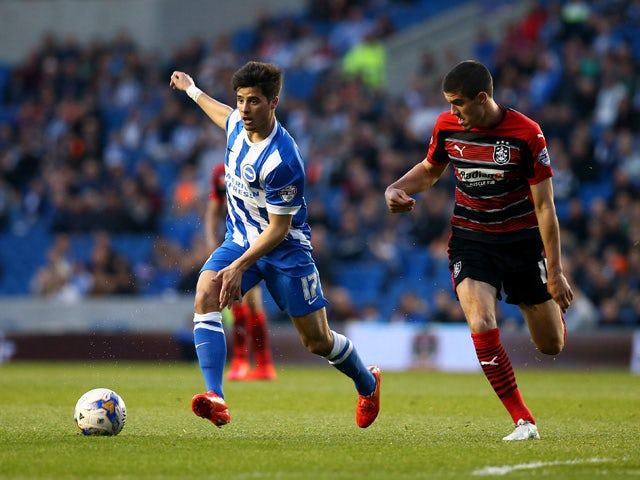 Brighton's Joao Teixeira looks to attack past Conor Coady of Huddersfield during the Sky Bet Championship match between Brighton & Hove Albion and Huddersfield Town at The Amex Stadium on April 14, 2015
