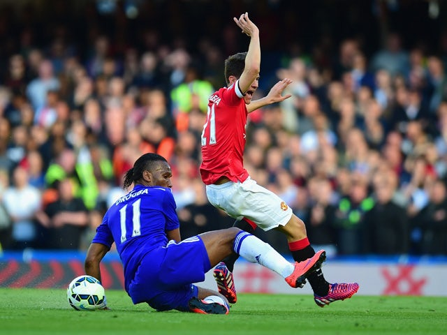 Didier Drogba of Chelsea tackles Ander Herrera of Manchester United during the Barclays Premier League match between Chelsea and Manchester United at Stamford Bridge on April 18, 2015