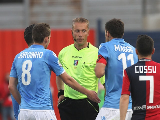 Christian Maggio of Napoli is sent off during the Serie A match between at Stadio Sant'Elia on April 19, 2015