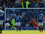 Ross Barkley of Everton takes a penalty that is saved by Thomas Heaton of Burnley during the Barclays Premier League match between Everton and Burnley at Goodison Park on April 18, 2015