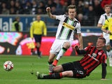 Frankfurt's defender Alexander Madlung and Moenchengladbach's midfielder Patrick Herrmann (L) vie for the ball during the German first division Bundesliga football match Eintracht Frankfurt vs Borussia Monchengladbach in Frankfurt am Main, central Germany
