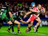 Charlie Sharples of Gloucester evades the tackle of Jack Nowell of Exeter during the European Rugby Challenge Cup semi final match between Gloucester Rugby and Exeter Chiefs at Kingsholm Stadium on April 18, 2015