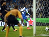 Porto's Colombian forward Jackson Martinez (R) scores a goal during the UEFA Champions League quarter final football match FC Porto vs FC Bayern Munich at the at the Dragao stadium in Porto on April 15, 2015