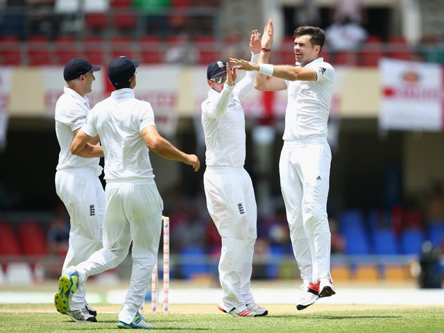 James Anderson of England celebrates taking the wicket of Devon Smith of West Indies during day two of the 1st Test match between West Indies and England at the Sir Vivian Richards Stadium on April 14, 2015