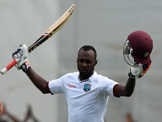 West Indies batsman Jermaine Blackwood celebrates scoring his century on day three of the first test match between West Indies and England at the Sir Vivian Richard Stadium in St John's, Antigua on April 15, 2015