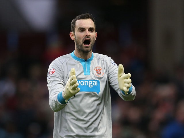 Joe Lewis of Blackpool gesticulates during the FA Cup Third Round Match between Aston Villa and Blackpool at Villa Park on January 4, 2015