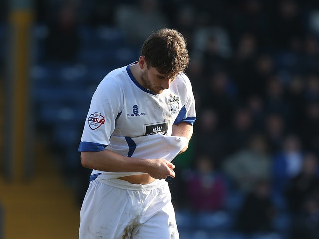 Joe Riley of Bury walks dejectedly from the pitch after being shown a red card by referee David Coote during the Sky Bet League Two match between Bury and Northampton Town at The JD Stadium on March 21, 2015