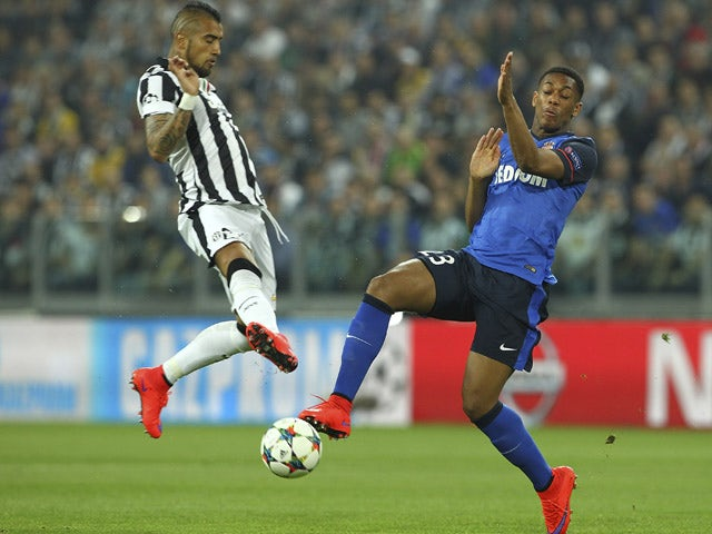 Anthony Martial of AS Monaco FC competes for the ball with Arturo Vidal of Juventus FC during the UEFA Champions League Quarter Final First Leg match between Juventus and AS Monaco FC at Juventus Arena on April 14, 2015