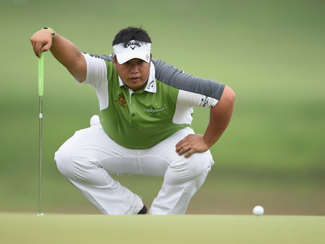 Kiradech Aphibarnrat of Thailand lines up a putt during the final round of the Shenzhen International at Genzon Golf Club on April 19, 2015