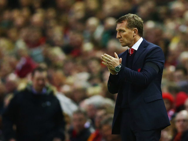 Brendan Rodgers manager of Liverpool applauds on the touchline during the Barclays Premier League match between Liverpool and Newcastle United at Anfield on April 13, 2015