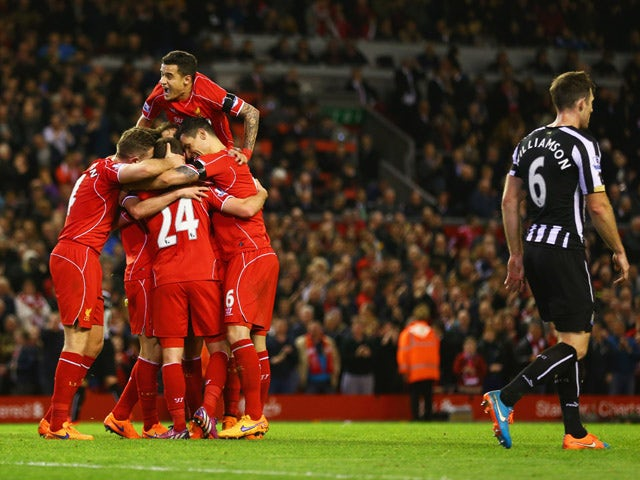 Joe Allen of Liverpool celerbates with team mates as he scores their second goal during the Barclays Premier League match between Liverpool and Newcastle United at Anfield on April 13, 2015