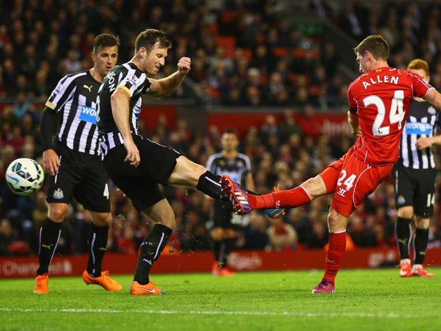 Joe Allen of Liverpool shoots past Michael Williamson of Newcastle United to score their second goal during the Barclays Premier League match between Liverpool and Newcastle United at Anfield on April 13, 2015