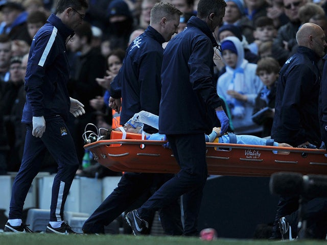 Manchester City's Spanish midfielder David Silva is carried off the field on a stretcher injured after taking a knock in the face in a challenge with West Ham United's Senegalese midfielder Cheikhou Kouyate during the English Premier League football match