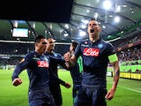 Napoli's Slovakian midfielder Marek Hamsik (R) celebrates after scoring his team's second goal with his team-mates during the UEFA Europa League first-leg quarter-final football match on April 16, 2015